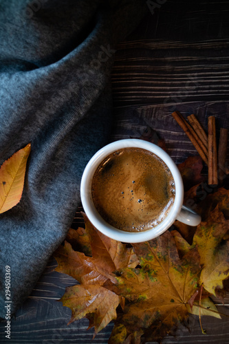 Cup of coffee with an autumn composition on wooden background. Vertical picture for blogging concept. Flat lay.