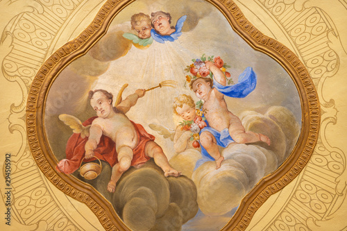 MENAGGIO, ITALY - MAY 8, 2015: The neobaroque fresco of angels with the holy water in church Chiesa di Santa Marta.