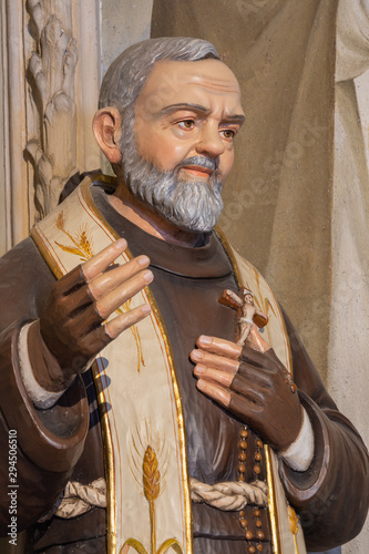 MENAGGIO, ITALY - MAY 8, 2015: The carved polychrome statue of Father Pio in church Chiesa di Santa Marta.