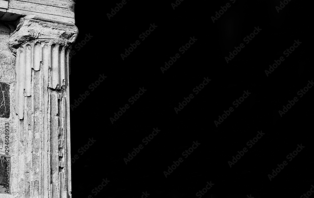 Fototapeta Ancient roman religious architecture. Column detail of the roman Temple of Portunus located in Forum Boarium, in the historic center of Rome, erected in the 1st century BC (Black and White with copy s