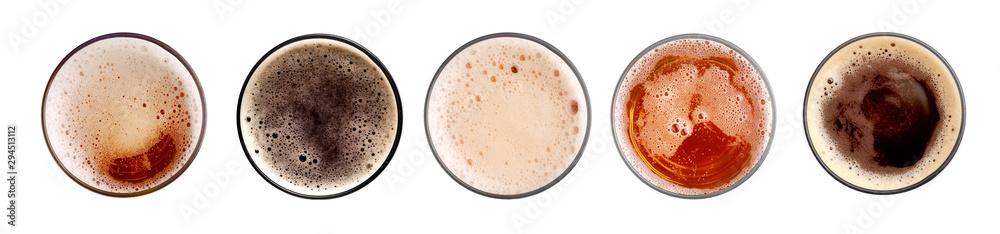 Fototapeta Glass of fresh beer on white background, top view