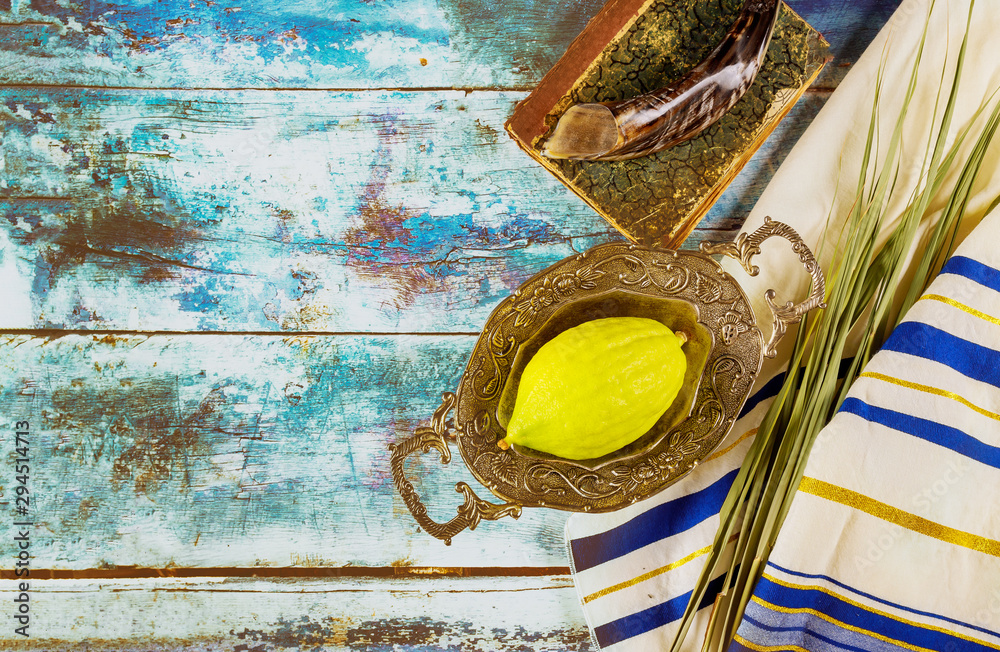 Fototapeta Religion jewish celebration holiday Sukkot. Etrog, lulav, hadas arava kippah and shofar tallit praying book