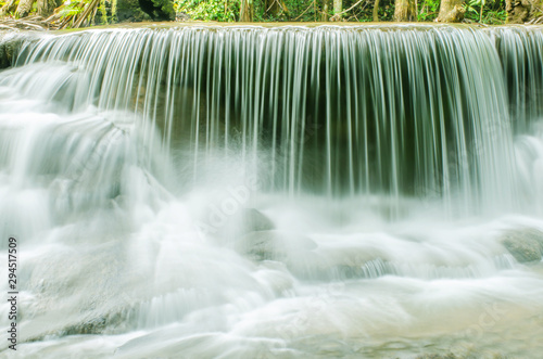 Deurstickers Bos rivier Travel to the beautiful waterfall in tropical rain forest, soft water of the stream in the natural park at Huai Mae Khamin Waterfall in Kanchanaburi, Thailand.
