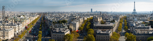 Tuinposter Parijs Cityscape of Paris with the Eiffel Tower and apartment buildings aerial view