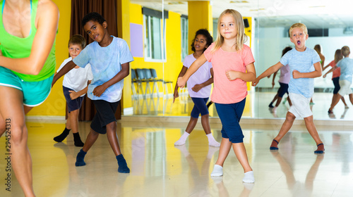 Active young children posing at dance class - 294524313