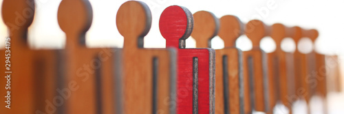 Fotografía  Male red plastic toy businessman silhouette wooden figure background closeup