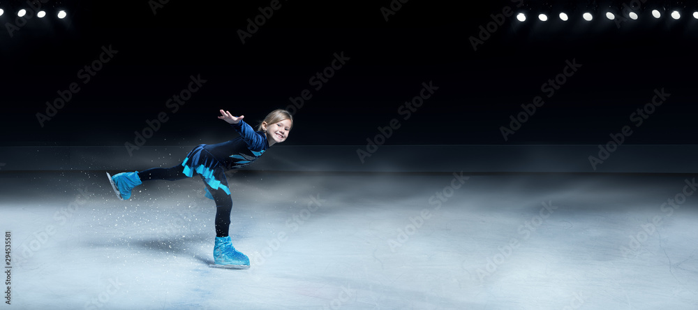 Fototapety, obrazy: view of child  figure skater on dark ice arena background