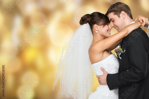 Fotomural  Happy just married young couple on black background, vintage