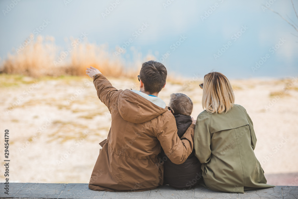 Fototapety, obrazy: young beautiful family sitting at beach with view lake