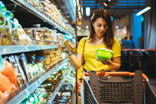 Young Pretty Adult Woman Do Shopping In Grocery Store
