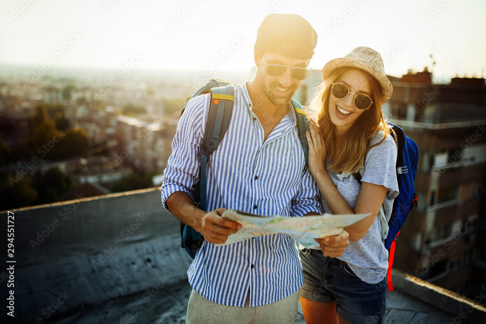 Fototapety, obrazy: Multiethnic traveler couple using map together on sunny day