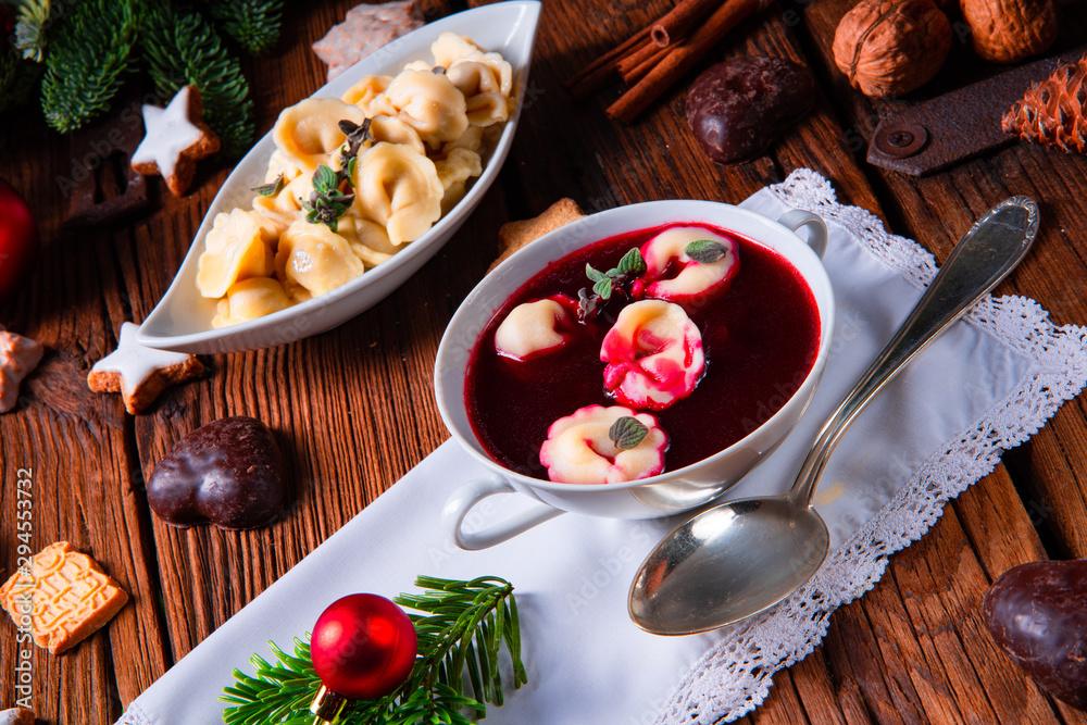 Fotografie, Obraz traditional Polish Christmas Eve borscht with dumplings