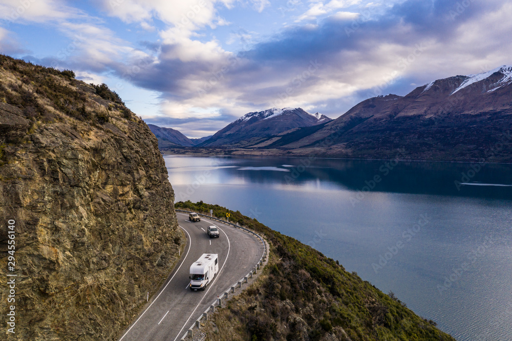 Fototapety, obrazy: Camping car driving along the stunning lake Wakapitu between Queenstown and Glenorchy in New Zealand south island at sunset