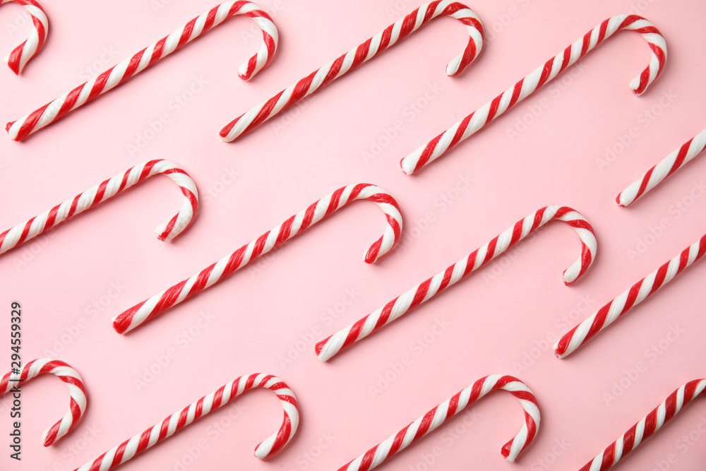 Fototapety, obrazy: Flat lay composition with candy canes on pink background