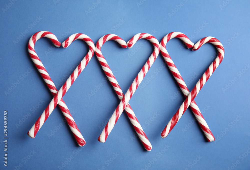 Fototapety, obrazy: Candy canes on blue background, flat lay
