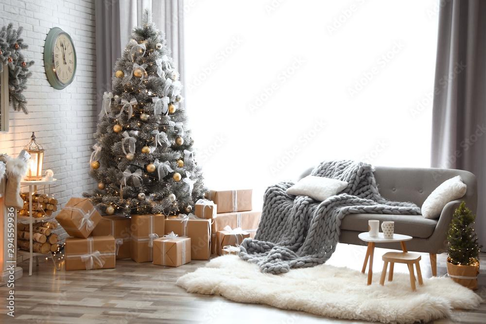 Fototapeta Stylish interior of living room with decorated Christmas tree