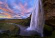 Stunning sunset at seljalandsfoss, iceland with flowing waterfalls