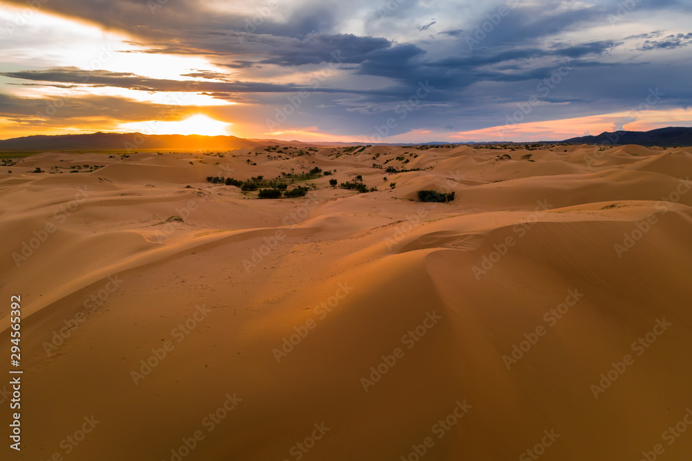 Fototapeta Sunset over the sand dunes in the desert