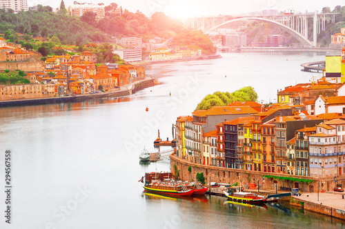 Porto, Portugal suny old town ribeira with colorful houses, Douro river. Sunset aerial perspective landmark.