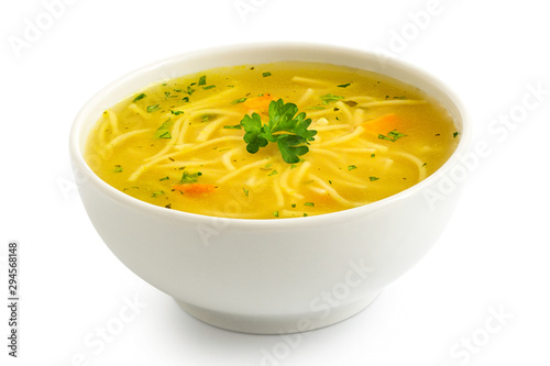 obraz lub plakat Instant chicken noodle soup in a white ceramic bowl isolated on white. Parsley garnish.