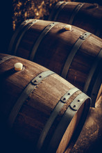 Wooden Barrels In A Dark Cellar