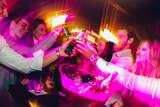 Happy young people having fun at nightclub.