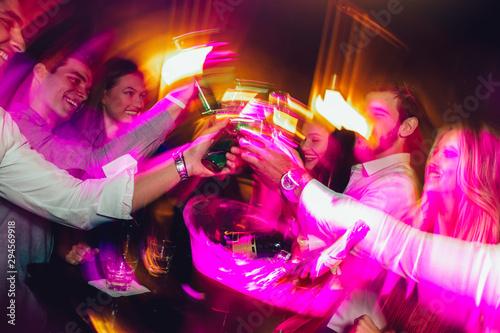 Obraz na płótnie Happy young people having fun at nightclub.