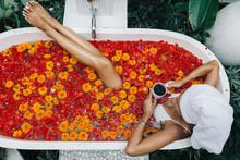 Woman Relaxing In Outdoor Bath...
