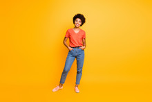 Full Length Body Size Photo Of Cool Swag Good Black Millennial Girl Posing In Front Of Camera Showing Her Coolness Wearing Jeans Denim Sneakers Isolated Over Vibrant Color Background