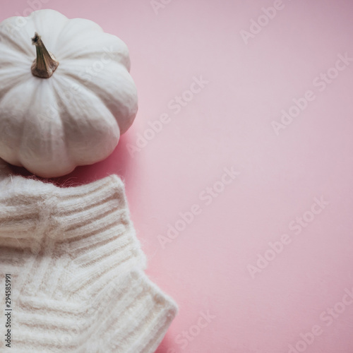 Fall composition with white sweater and pumpkin