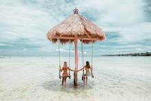 Girl On Beach Swing On Bali Island