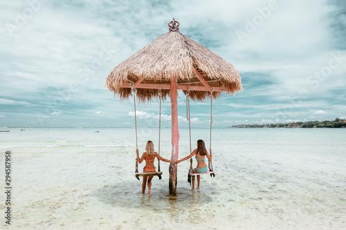 Cuadros en Lienzo Girl on beach swing on Bali island