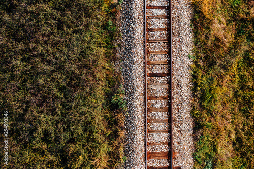 Recess Fitting Railroad Old railroad track through countryside in autumn, aerial view