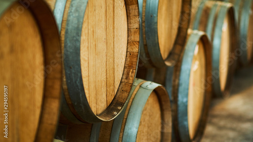 Fotografie, Tablou Wine barrels stacked in the old cellar of the winery.