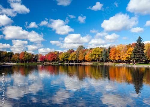 Foto auf Leinwand Wasserfalle Autumn trees reflected on Beaver Lake, Mont Royal, Montreal, Quebec, Canada
