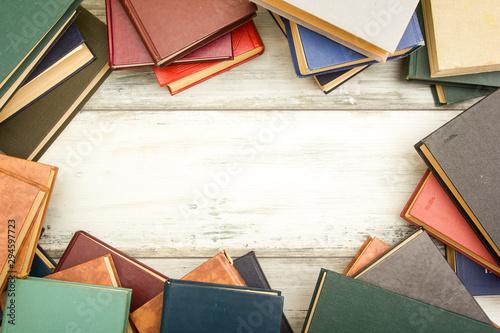 Fotografie, Tablou Open book, hardback books on wooden table