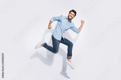 Cuadros en Lienzo Full length photo of funny multiethnic guy jumping high fun competition particip