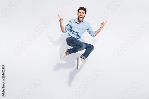Cuadros en Lienzo Full length photo of wild indian guy jumping high at hard rock concert making fi