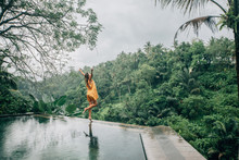 Woman Enjoying Tropical Rain W...