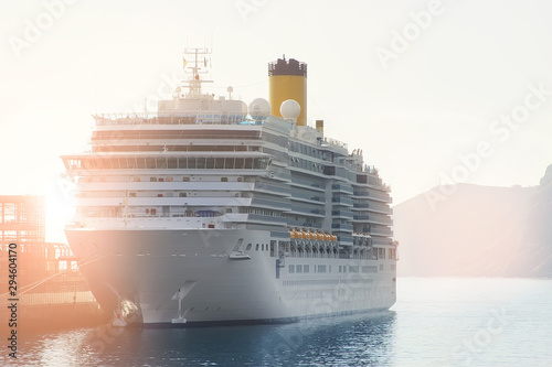 Fototapeta Big modern white cruise ship liner morred with mooring cable port of sea or ocean at beautiful morning sunrise time. Travel and vacation. Adventure journey beginning concept obraz