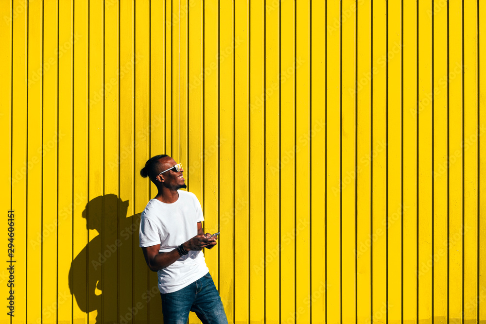 Fototapety, obrazy: Portrait of handsome afro man using his mobile.