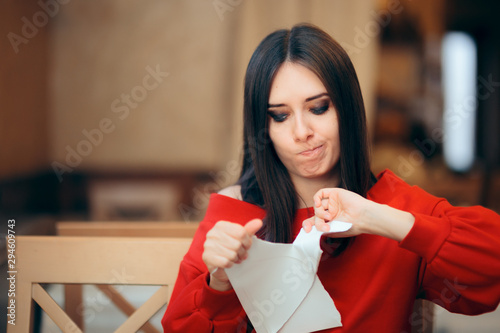 Woman Tearing Up Documents in a Restaurant