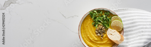 panoramic shot of tasty mashed pumpkin soup on marble surface
