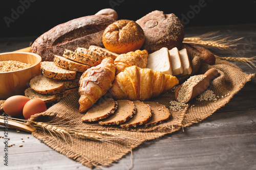 Recess Fitting Bread Different kinds of bread with nutrition whole grains on wooden background. Food and bakery in kitchen concept. Delicious breakfast gouemet and meal. Carbohydrate organic food cuisine homemade