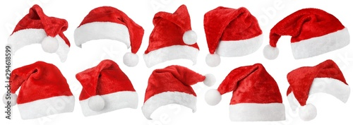 Leinwand Poster Set of red Christmas Santa Claus hat isolated on white background