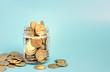 Leinwanddruck Bild - Glass jar for tips with money isolated