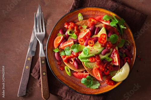 Fotobehang Kruidenierswinkel mexican avocado bean sandwich with tomato chili scallion