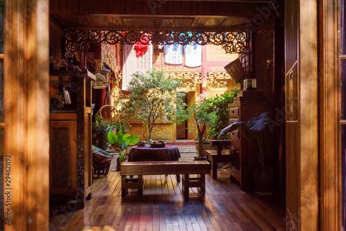 Fototapeta Amazing cozy courtyard of traditional Chinese wooden house obraz