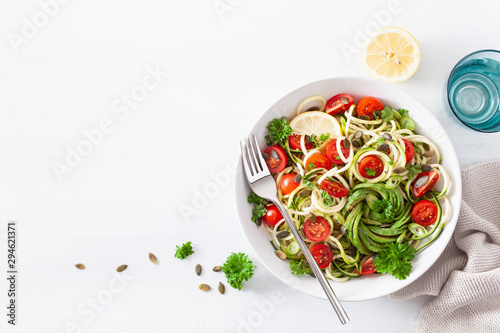 Poster Asia Country vegan ketogenic spiralized courgette salad with avocado tomato pumpkin seeds