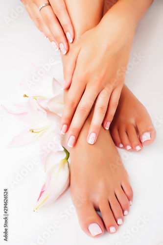 Photo sur Toile Pedicure manicure pedicure with flower lily close up isolated on white perfect shape hands spa salon